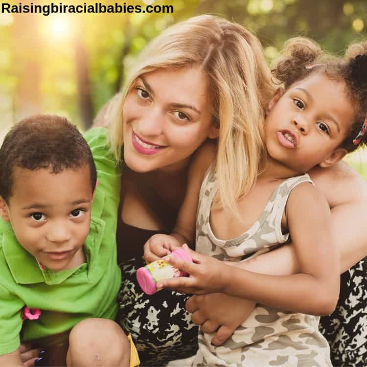 Caucasian mom with mixed race son and daughter