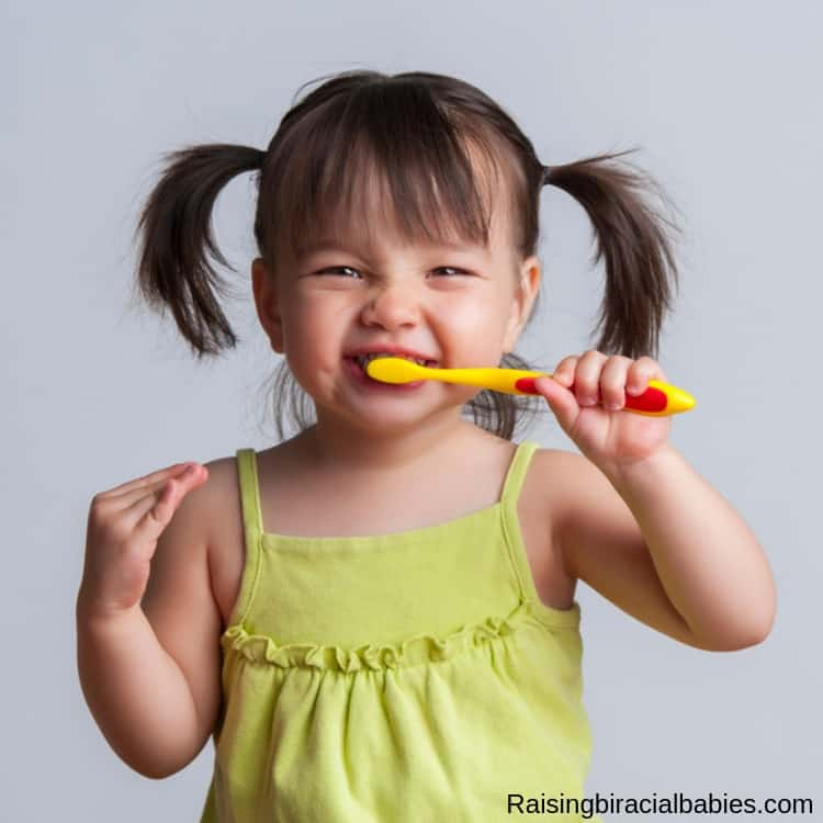 Learn how to brush your toddler's teeth even if they hate brushing!