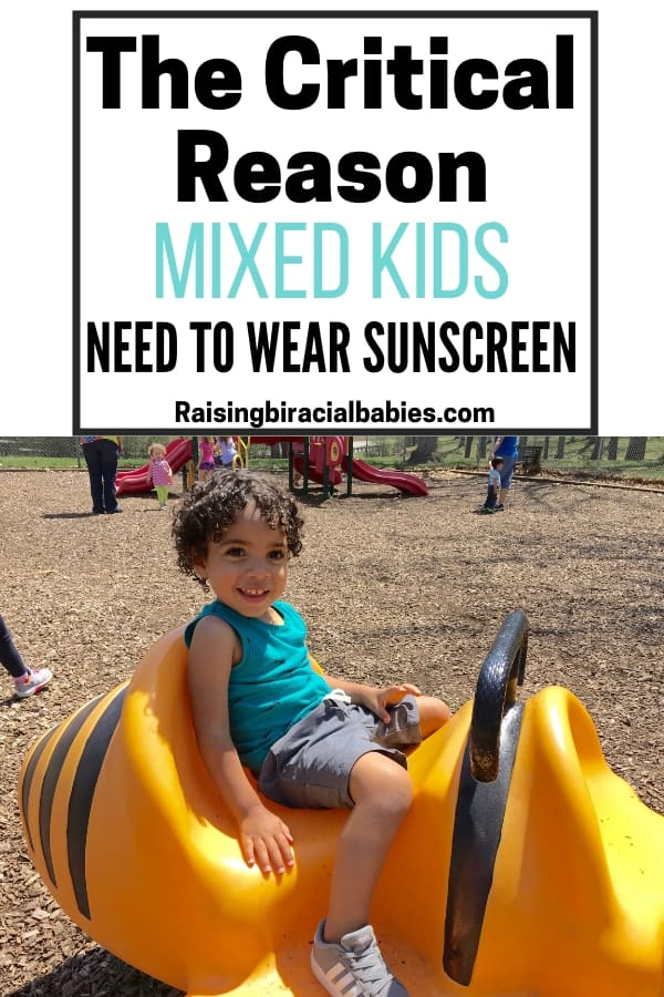 little mixed boy in the sun on playground equipment with text overlay that says the critical reason mixed kids need to wear sunscreen.