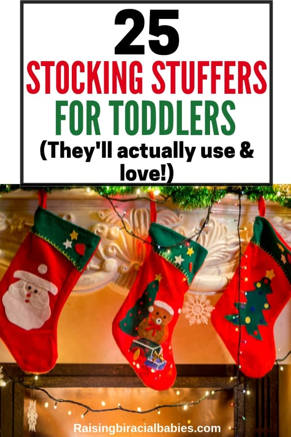 three children's stocking stuffers hanging on a fireplace mantel with text overlay that says 25 stocking stuffers for toddlers they'll actually use and love.