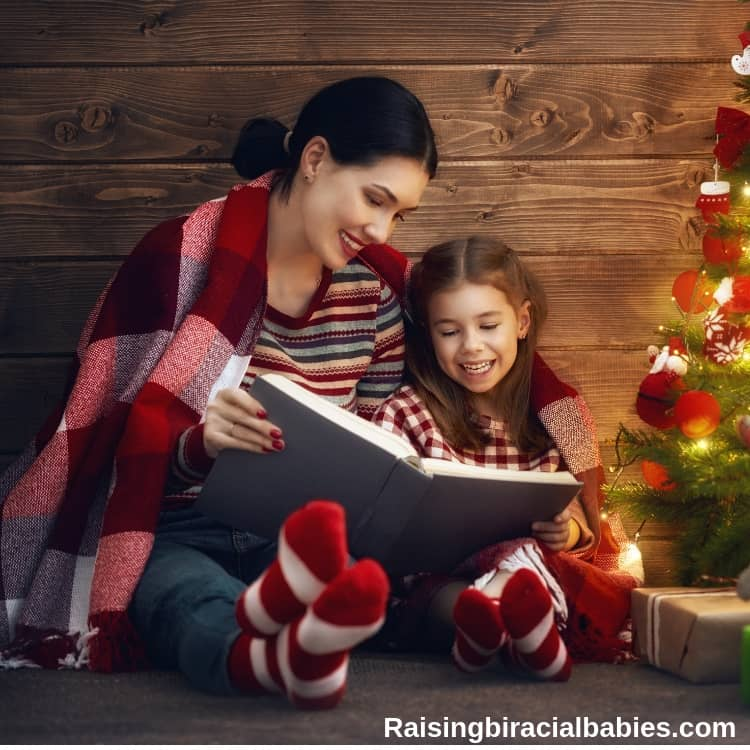 mother reading book to daughter