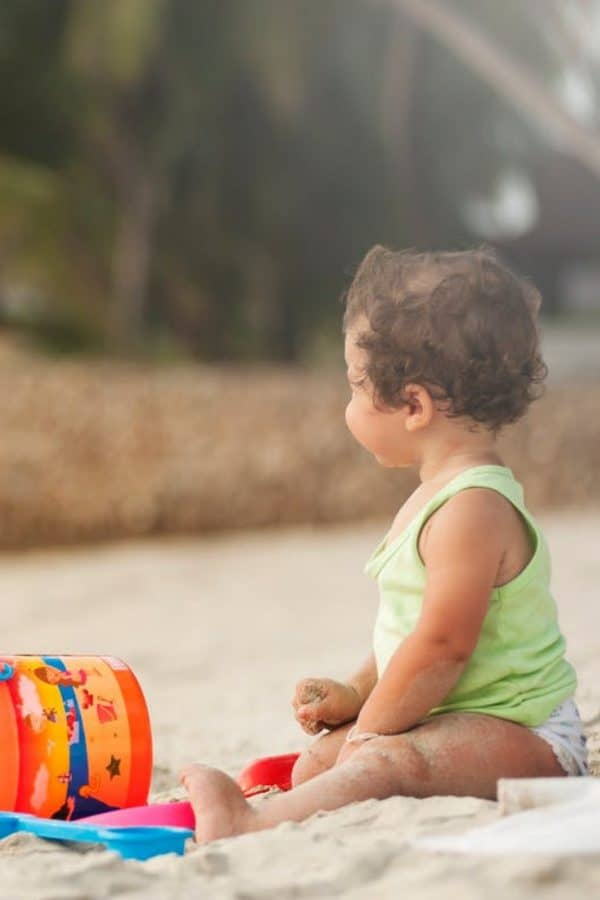 toddler enjoying time at the beach, a fun summer activity
