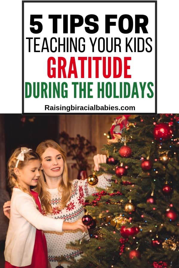 A mom and daughter decorating a christmas tree with text overlay that says 5 tips for teaching your kids gratitude during the holidays