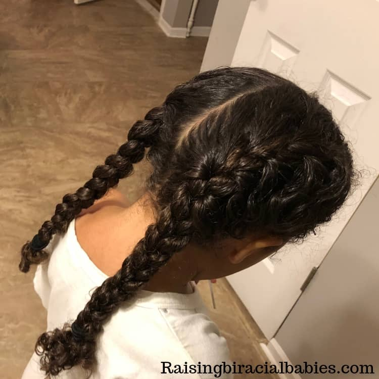 french braid pigtails for biracial curly hair. One of many cute braided hairstyles for mixed hair.