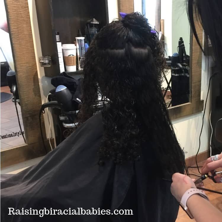 Getting frequent trims helps biracial curly hair grow