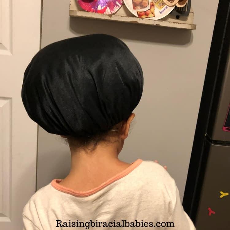 Get a satin bonnet to keep mixed hair protected at night