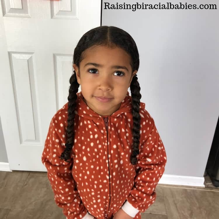 Low braided pigtails for mixed curly hair