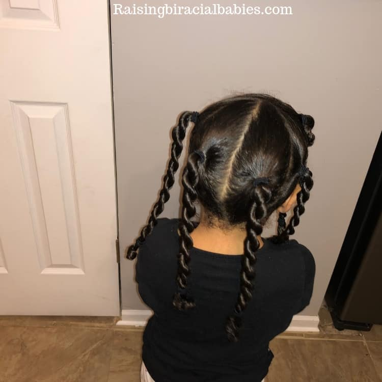 a two strand twist, cute biracial hairstyle