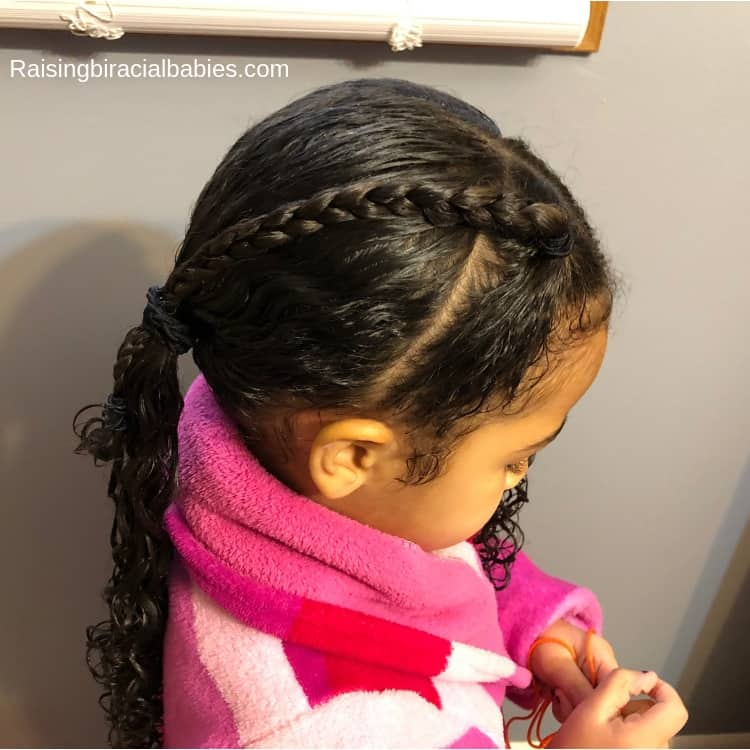 Tie the front braid into the ponytail for this mixed kids hairstyle