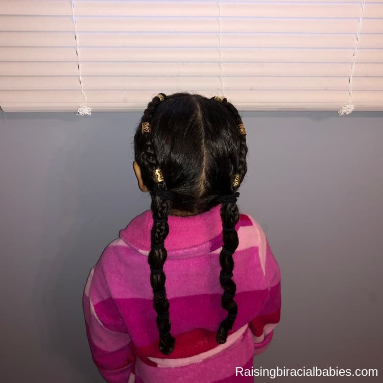 Add box braid cuffs as pretty accessories for this mixed kids hairstyle