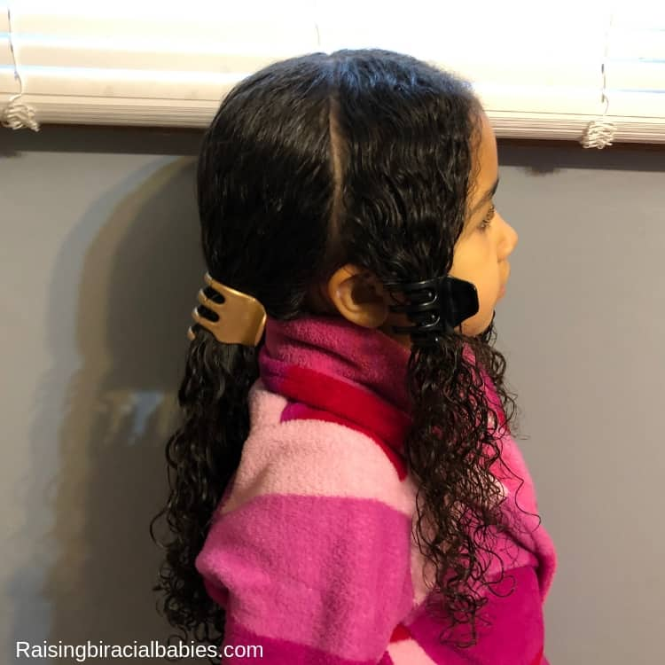 begin by parting the hair behind the ear for this mixed kids hairstyle