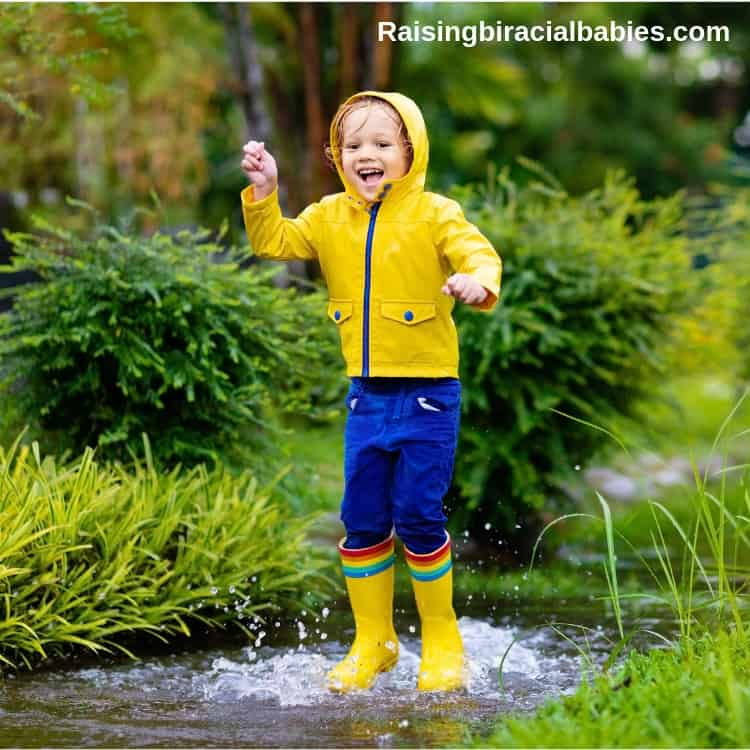 a child jumping in a puddle, which is a fun spring activity for kids