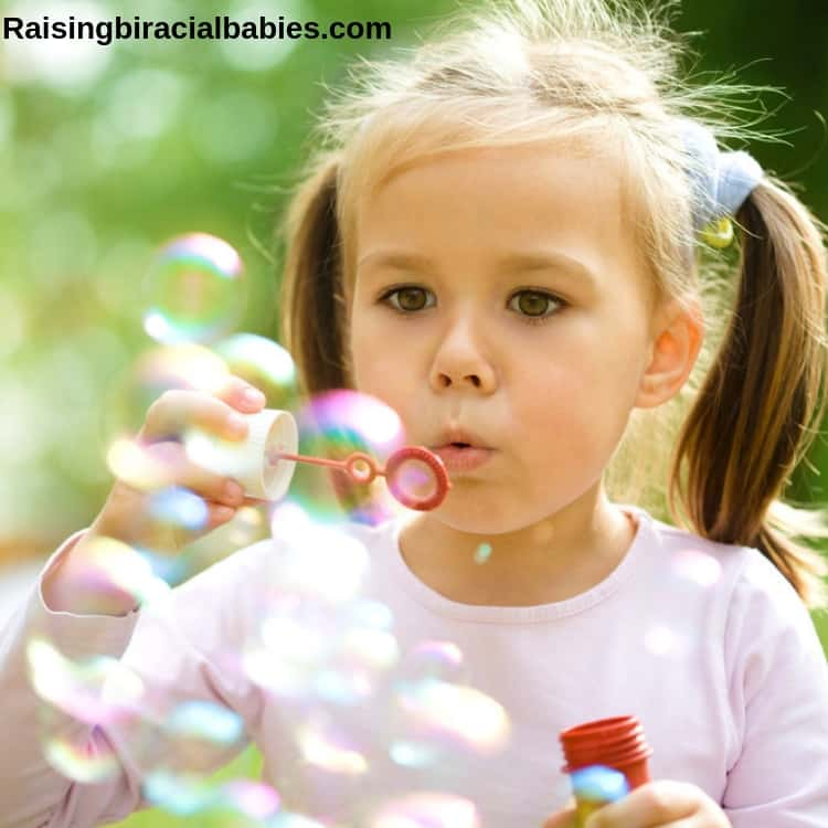 blowing bubbles is another fun spring activity for kids