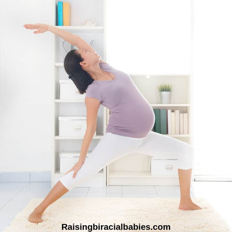 pregnant woman doing yoga to distract herself during early labor