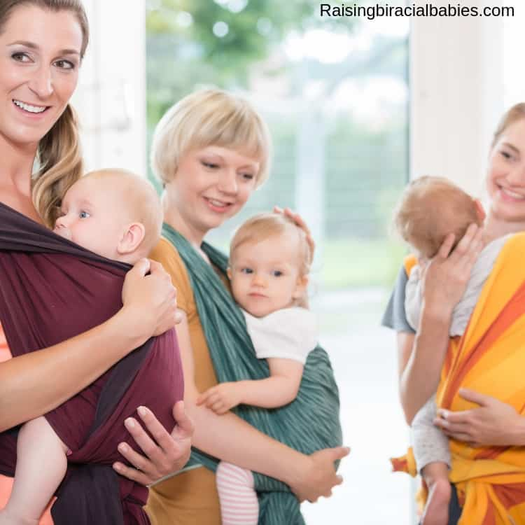 three mothers babywearing their kids with wraps.