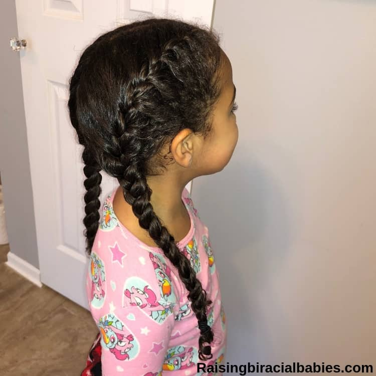 little girl with french braid pigtails