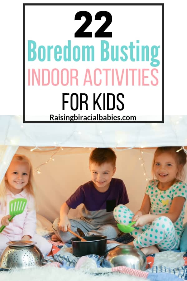 three little kids laughing inside a fort using kitchenware and pots as instruments with text overlay that says 22 boredom busting indoor activities for kids