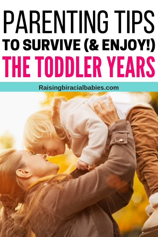 a mother holding her toddler up in the air outside, with their faces close together in a moment of happiness with text overlay that says parenting tips to survive and enjoy the toddler years.