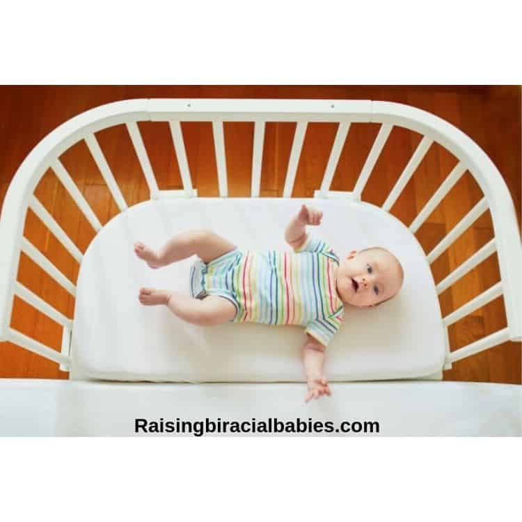 infant in a co-sleeper flush with the parents mattress.
