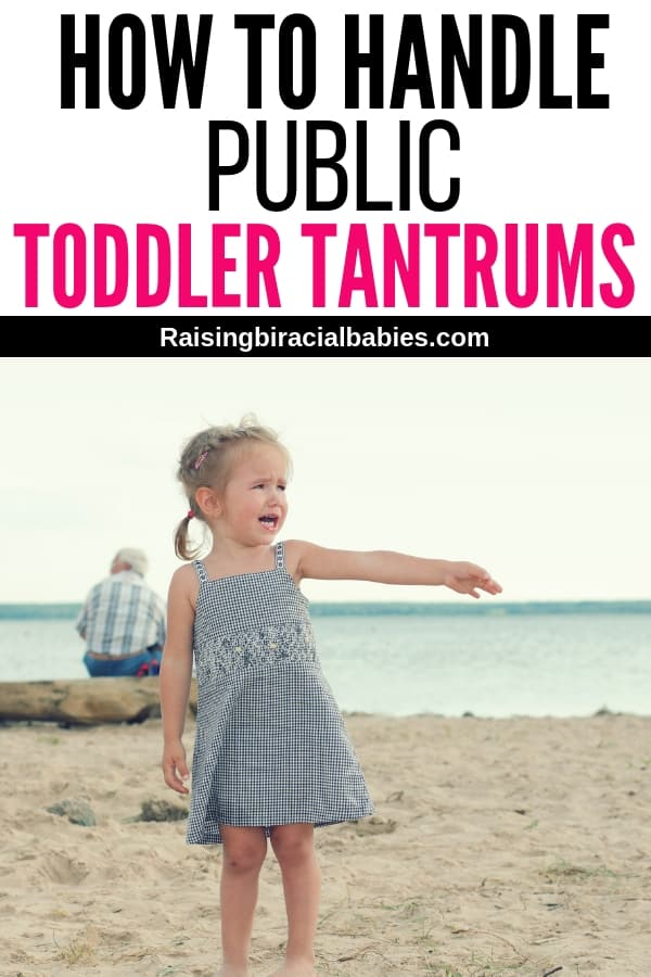 a little toddler girl crying in the middle of a tantrum on the beach with text overlay that says how to handle public toddler tantrums.
