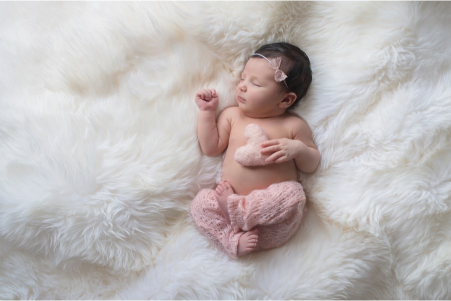 newborn baby girl on a fluffy white background