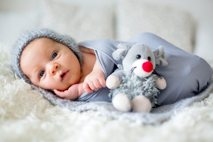 a close up of a newborn baby boy