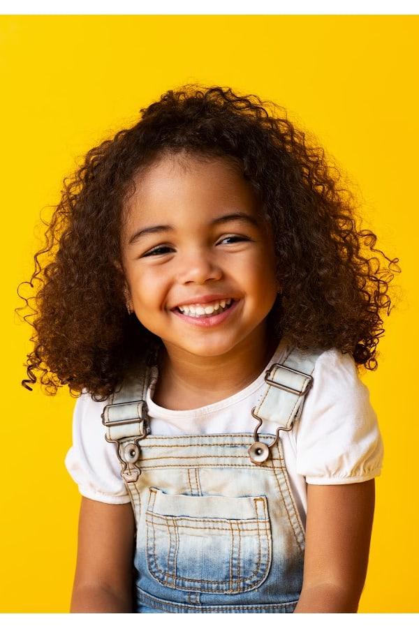 a close up of a biracial girl smiling
